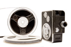 Home movie camera and film reel isolated on white Royalty Free Stock Images