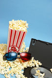 Home Movie. A 3D home movie experience with popcorn and glasses Stock Photo