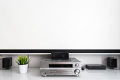Home multimedia center setup in room. Home multimedia center with wide cinema theater screen in room. Space for text on screen royalty free stock images