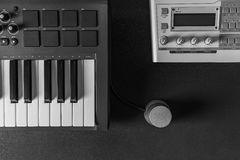 Home music studio dj and producer equipment on dark background Royalty Free Stock Photography