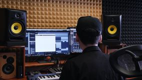 Home music studio. Sound engineer mixing and mastering at sound music studio. Digital audio workstation. Home recording studio. Home music studio. Sound stock footage