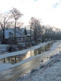Home near river in winter Stock Photo