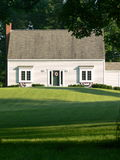Home: New England cottage. White New England cottage with U.S. wreaths Royalty Free Stock Image