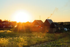 HOME no sol Fotos de Stock Royalty Free