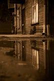 Home nostalgia. Sepia coloured shot of house with reflection Royalty Free Stock Photos