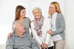 Home nursing for senior citizen. Couple with caregiver at home stock image