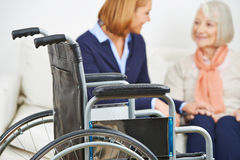 Home nursing for senior woman with wheelchair. Caregiver from home nursing service for senior women with wheelchair Royalty Free Stock Image