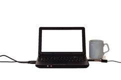 Home office 08. A computer and equipment with a white backround, the computer screen is white ready for message or image Royalty Free Stock Photography