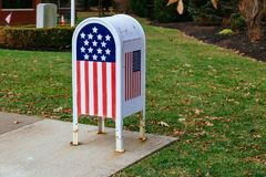 Home office American flagMetal Mailbox in garden. Home office American flag Metal Mailbox in garden Stock Photos