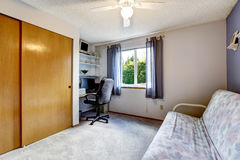 Home office area with sofa and built-in wardrobe. Stock Photography