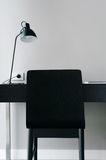 Home office with a blank wall Stock Images