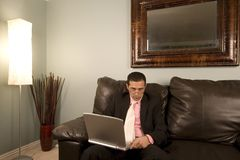 Home or Office - Businessman Working on the Couch Stock Images