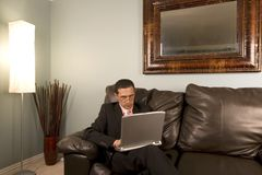 Home or Office - Businessman Working on the Couch Stock Photography