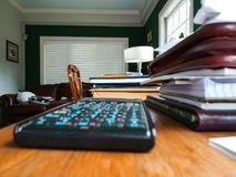 Home office with calculator - low view and selective focus royalty free stock photo