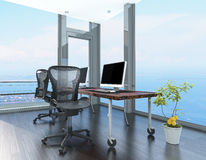 Home office in a coastal apartment. With wraparound glass -to-ceiling windows overlooking the sea and a corner computer workstation on wheels stock image