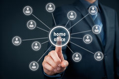 Home office concept. Home office (home-office) concept. Businessman click on home office button linked with employees working on notebooks Royalty Free Stock Photography