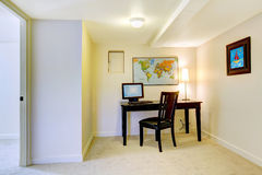 Home office desk with map on the white wall. Stock Image