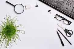 Home office desk workspace mockup with black keyboard, glasses, pen, pencil, eraser, scissors, clips and office plant. Flat lay, copy space, top view stock images