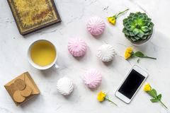 Home office with flowers spring concept on marble background top view Royalty Free Stock Photos