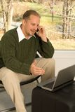 Home office phone conversation Stock Image