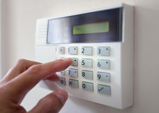 Home or office security. Security alarm keypad with person arming the system concept for crime prevention Stock Photography