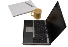 Home office setup. Laptop, coffee, paper isolated on white Royalty Free Stock Photography