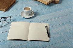 Home office table with open notebook Royalty Free Stock Photos