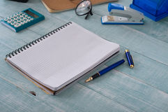 Home office table with open notebook  with pen. Home office table with open notebook with blank pages with pen. Top view with copy space Royalty Free Stock Photography