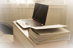 Home office. Work at home - freelancing. Home office - a laptop, a folder with documents, a sofa, sunny good weather royalty free stock image