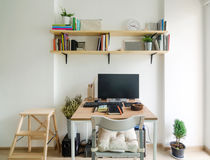 Home office working space. Wooden shelf with white wall Royalty Free Stock Images