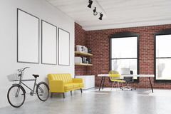 Home office: yellow chair, three posters side view Royalty Free Stock Photos