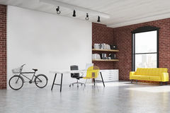Home office with yellow sofa Stock Images