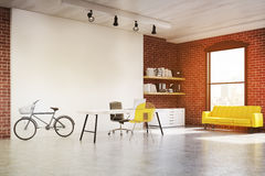 Home office with yellow sofa, toned Stock Photo