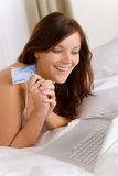 Home online shopping - woman with credit card Stock Images