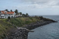 A Home Overlooking The Ocean On Terceira Island in the Portuguese Azores royalty free stock photos
