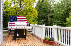 Home outdoor patio with BBQ cooker preparing for holiday picnic Royalty Free Stock Photo