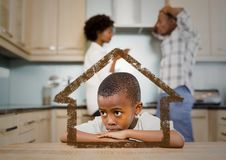 Home outline with son and parents arguing in kitchen Royalty Free Stock Images