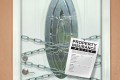 Home owner's property insurance policy hanging from chains on Stock Photography