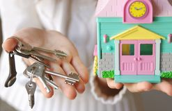 Home owner. Somebody is showing to you toy house and keys for it Royalty Free Stock Photography