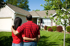 Home: Owners Admiring their Home stock photos