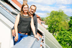 Home Owners Are Happy With Solar Panels On His Roof Stock Photography