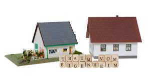 Home Ownership. Wooden cubes and the german words dream of home ownership isolated over a white background Stock Photos