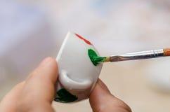 Home painted ceramic tea cup. Homemade painted ceramic tea cup stock photos