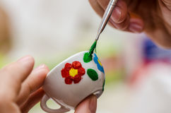 Home painted ceramic tea cup. Homemade painted ceramic tea cup royalty free stock images