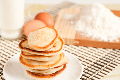 Home pancakes, flour and eggs Royalty Free Stock Image