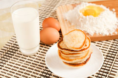 Home pancakes, flour and eggs Stock Images