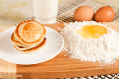 Home pancakes, flour and eggs Stock Image