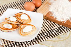 Home pancakes with sour cream royalty free stock images
