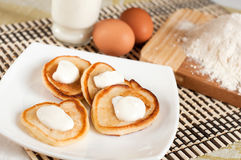 Home pancakes with sour cream stock photography