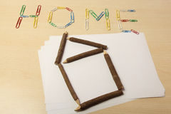 Home with paper clips Royalty Free Stock Images